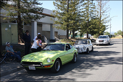 green 240z at 1st checkpoint
