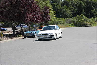 white bmw leaving checkpoint
